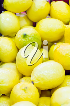 Photo of background with yellow ripe lemon
