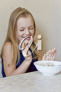 Photo of eating cute girl with blond hair
