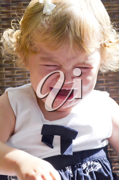 Cute crying baby girl with blond hair