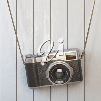 Vintage retro photo camera hanging on the white wooden wall. 3d illustration