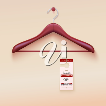 Red tag with special offer sign hanging on wooden hanger