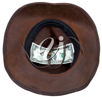 Leather brown cowboy hat with 2 dollars banknote within
