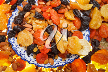 top view of oriental dessert - dried sweet fruits on arabic plate