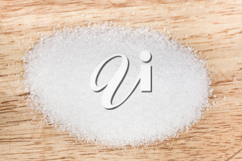 pinch of finely ground sea salt on a wooden board