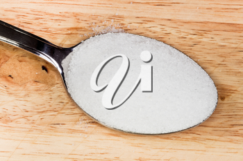 spoon of finely ground sea salt close up