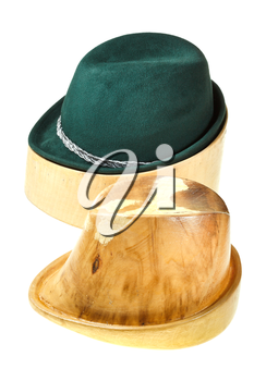 hunting felt hat on linden wooden hat block and additional hat block isolated on white background
