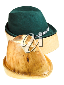 bavarian felt hat on linden wooden hat block and additional hat block isolated on white background
