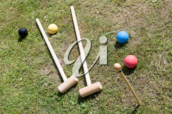 croquet equipment for game of croquet on green lawn in summer day
