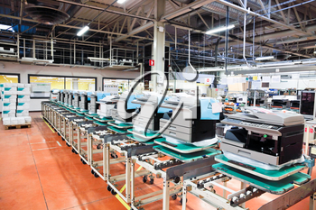 assembly line of office devices on factory