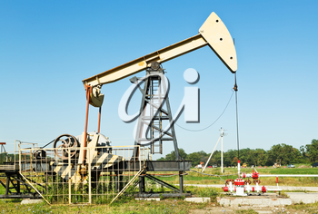 oil extraction by pumpjack in Caucasus region in summer day