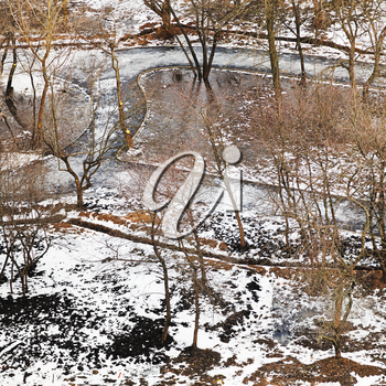 above view of ways in urban park in spring thawing