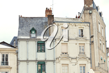 facades of medieval half-timbered urban houses in Angers city, France