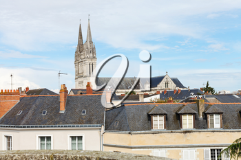 tower of Saint Maurice Cathedral and roofs of houses in Angers city, France