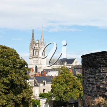 skyline with Saint Maurice Cathedral and wall of Angers Castle, France