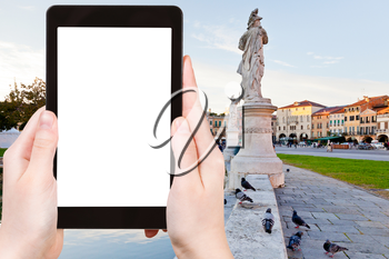 travel concept - tourist photograph square Prato della Valle in Padua, Italy on tablet pc with cut out screen with blank place for advertising logo