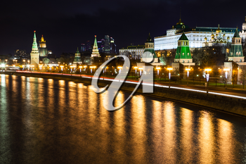 night cityscape with Kremlin embankment and Moskva River in Moscow