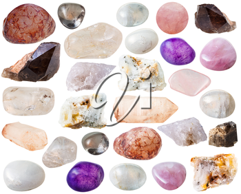 macro shooting of collection natural rock - various quartz mineral gem stones and crystals isolated on white background