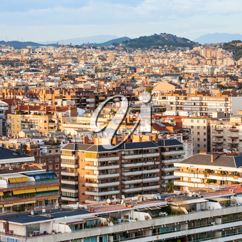 above view of residential buildings in Barcelona city on sunset