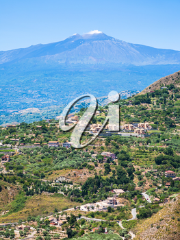 travel to Italy - view of green countryside and Etna volcano in Sicily
