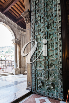 MONREALE, ITALY - JUNE 25, 2011: entrance of Duomo di Monreale in Sicily. The cathedral of Monreale is one of the greatest examples of Norman architecture, it was begun in 1174