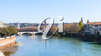 travel to Italy - view of Adige river with Ponte della vittoria in Verona city in spring