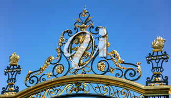 Travel to Provence, France - decoration of gate of ancient Jardins de la fontaine (Fountain Gardens) in Nimes city