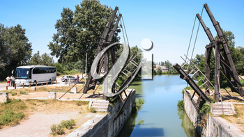 ARLES, FRANCE - JULY 7, 2008: visitors near Pont Van Gogh, replica of the Langlois Bridge, drawbridge which was the subject of several paintings by Vincent van Gogh in 1888, on Canal d'Arles a Fos
