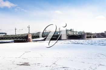 The Palace Bridge and frozen Neva river in Saint Petersburg city in March