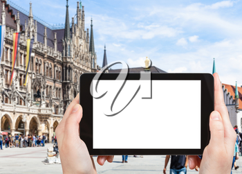 travel concept - tourist photographs of Marienplatz (Mary's Square) in Munich city in Germany on smartphone with empty cutout screen with blank place for advertising