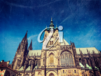 Vintage retro hipster style travel image of Gothic architecture facade of St. Vitus Catherdal, Prague, Czech Republic with grunge texture overlaid