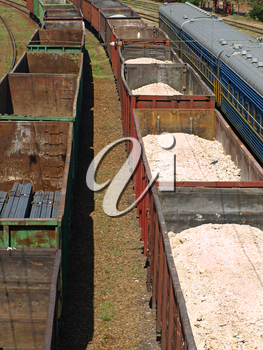 Freight trains of metal profile and sulfur on a rails.