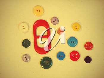 Set of buttons on yellow fabric suitable as background.Tonal correction.