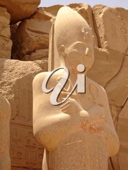 Statue of Ramses with the keys of life in his hands in the Karnak temple.