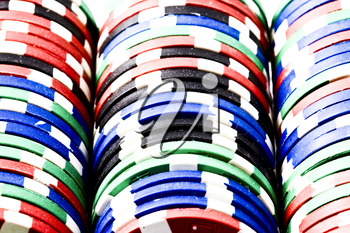 Poker chips in rack colorful and in rows