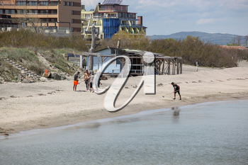 Pomorie, Bulgaria - May 01, 2019: Cleaning the Beach Before The New Seaside Season.