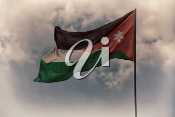 in jordan the national flag in the wind and sky