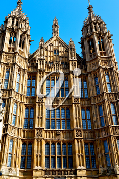 in london old historical  parliament glass    window    structure and sky