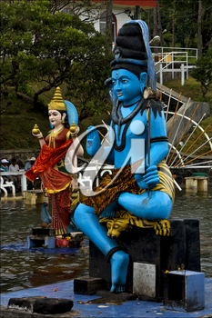 marble blue wood statue of a Hinduism  snake  Shiva vishnu Brahma in a temple near a lake in mauritius africa