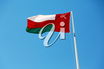 and the cloudy sky in oman waving flag