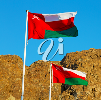 and the cloudy sky in oman waving flag mountain