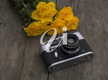 film retro camera and bouquet of yellow roses, subject festive card, flowers