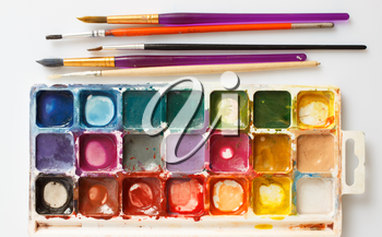 Closeup of water-color paint-box and paint brushes