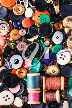 Texture of variety of buttons from clothing and thread.Top view