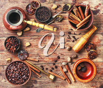 Coffee still life with beans,cinnamon,anise and brown sugar.Copy space