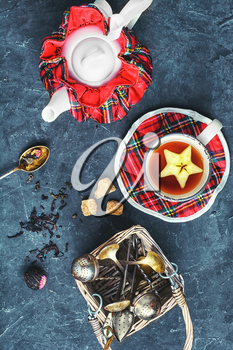 Set of the stylish kettle and Cup of tea on the slate background