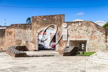 Ciudad Colonial, Santo Domingo, Dominican Republic, street view withold stone gateway