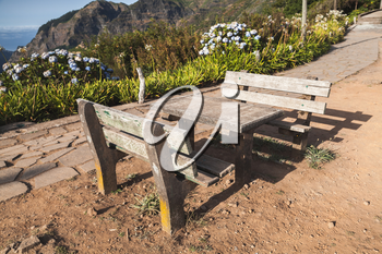 Two outdoor benches and table in Mountain village Serra De Agua of Madeira island, Portugal