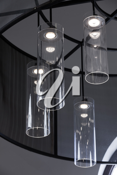 Modern interior design, vertical fragment, chandelier with round glass lampshades and white LED lights