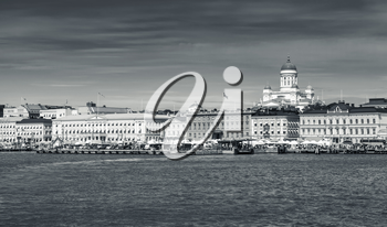 Monochrome Helsinki cityscape. Central quay, building facades and dome of the main city cathedral