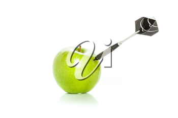 Green apple as a target for black steel dart, closeup photo on white background